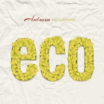 黄色の葉で作られたエコ文字でしわしわの紙の上の秋のテーマデザイン