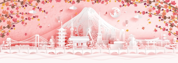 Autumn in tokyo, japan with falling maple leaves and world famous landmarks