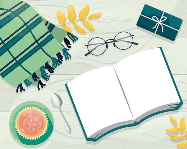 책, 안경, 양모 스카프, 컵 케 익와 단풍 이을 상위 뷰.