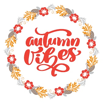 Autumn vibes calligraphy lettering text in frame of branch leaves and flowers