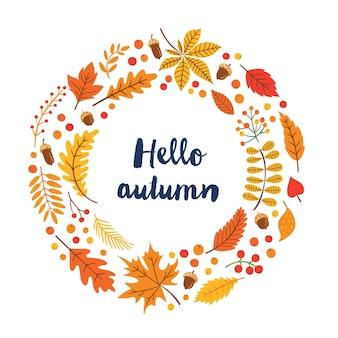 落ち葉、どんぐり、ベリー、季節の花の要素とテキスト「ようこそ秋」と秋の花輪。手描きの植物要素から作られた丸いフレーム。