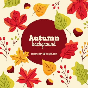 Autumnal background with leaves and chestnuts