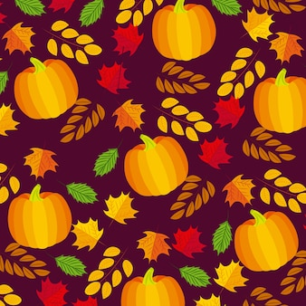 Autumnal leaves and pumpkins composition