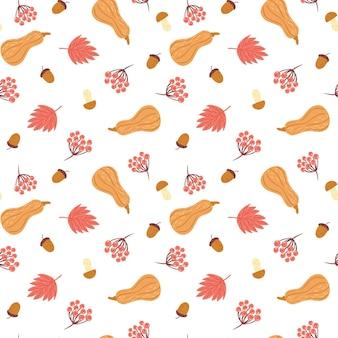 Осенний фон с кленовым листом, тыквой, желудем и рябиной.