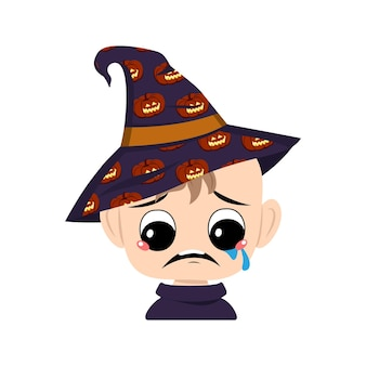 Avatar of child with big eyes and depressive emotion, crying, tears face in a pointed witch hat with pumpkin. the head of a toddler with sad face. halloween party decoration