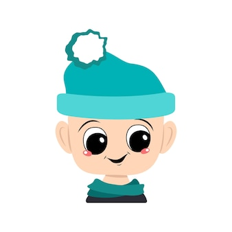Avatar of a child with big eyes and a wide happy smile in a blue hat with a pompom. head of a toddler with a joyful face
