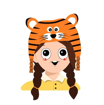 Avatar of a girl with big eyes and a wide smile in a tiger hat. cute kid with a joyful face in a festive costume for new year, christmas and holiday. head of adorable child with happy emotions
