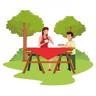 アバター女性とピクニック用のテーブルの少年