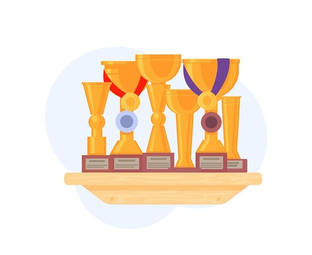 棚の上の賞とトロフィーカップとメダル