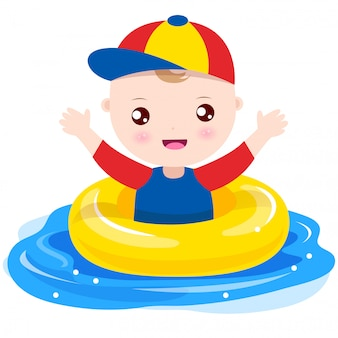 Baby boy playing with swim ring