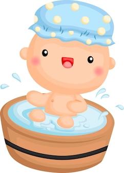 A baby boy taking shower in a wooden bathtub