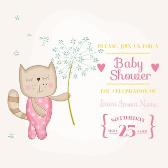 花を保持している女の赤ちゃん猫