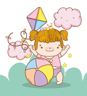 Baby girl with kite and ball toys