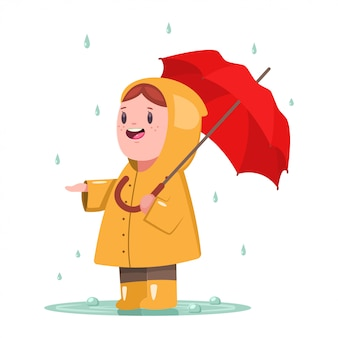Baby girl in yellow raincoat with umbrella