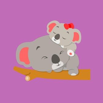 Маленькая коала спит со своим детенышем коала на ветке дерева