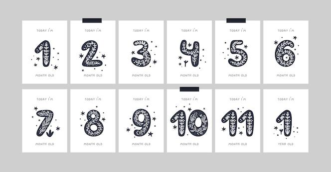 生まれたばかりの女の子または男の子のための花と数字が付いた赤ちゃんのマイルストーンカード。ベビーシャワーのプリント。 mensiversaryまたはmonthiversaryカード