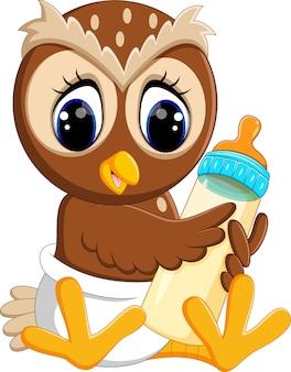 Baby owl holding milk bottle
