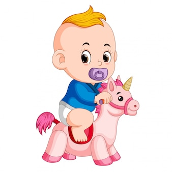The baby play with unicorn toy