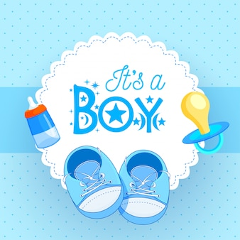 Baby shoes with pacifier and baby bottle on blue background for