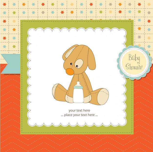 子犬のおもちゃを持つベビーシャワーカード Premiumベクター