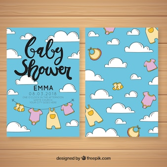 Baby shower invitation with clothes elements