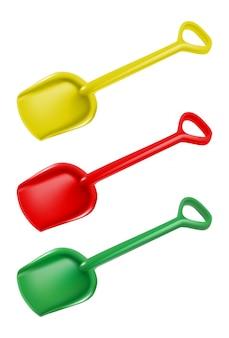 Детские лопаты в желтый, зеленый и красный. отдельные иконки иллюстрации.