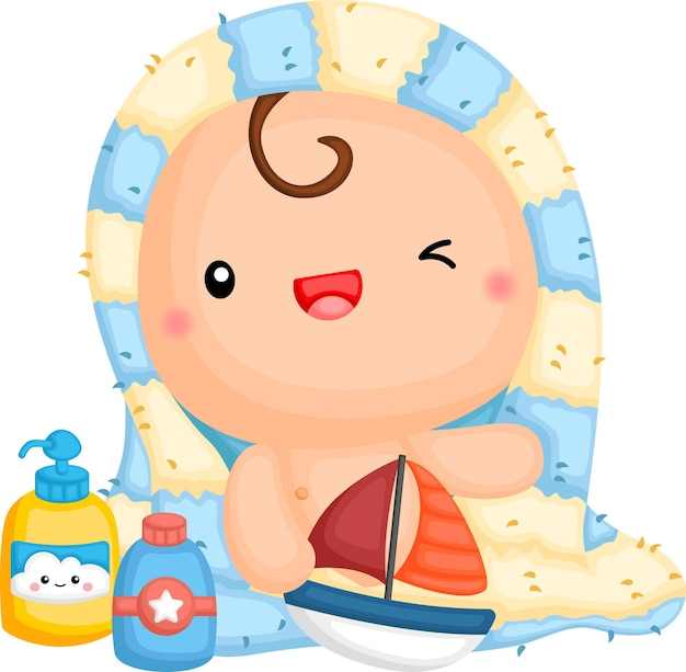 A baby wrapped in a towel holding a toy