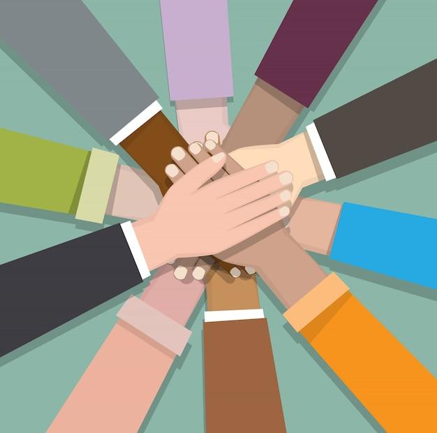 Разнообразные руки сотрудничают вместе на зеленом bacgkround