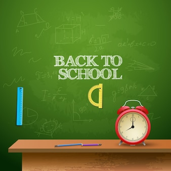 Back to school background with alarm clock, rullers and chalkboard