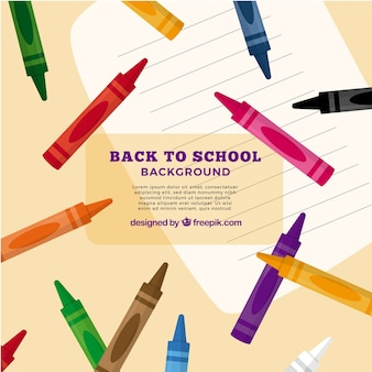 Back to school background with colored crayons