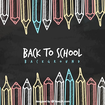 Back to school background with pencils on blackboard