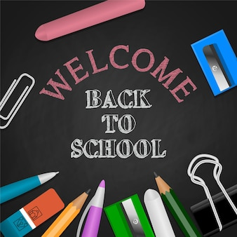 Back to school background with stationeries and chalk writing on chalkboard illustration