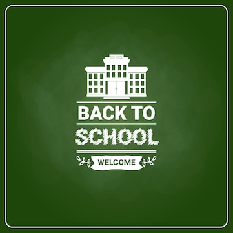 Back to school chalked label on green board background