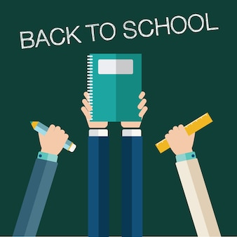 Back to school concept, hands holding school items