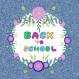Back to school. denim jeans background with floral frame decoration.