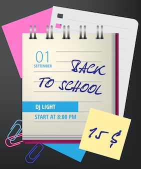 Back to school lettering with notebook and paper clips