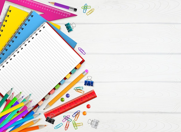 Back to school realistic background with colorful stationary on wooden surface