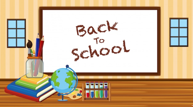 Back to school sign in classroom with school equipments