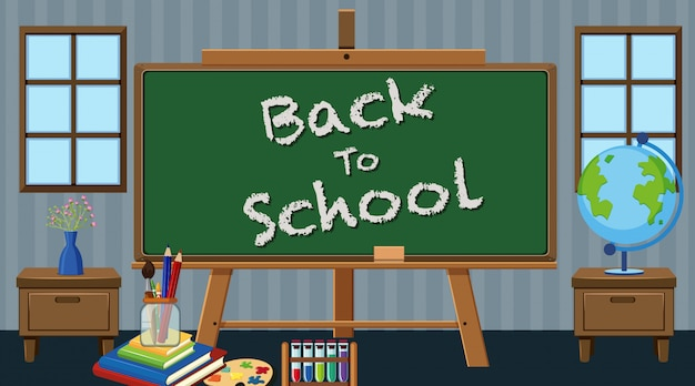 Back to school sign with school items in classroom