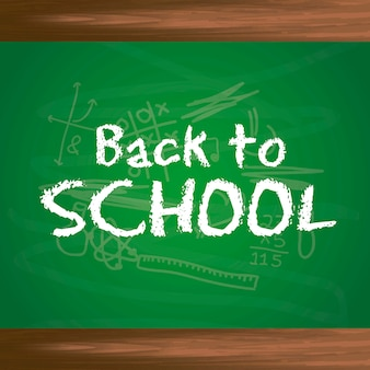 Back to school text over chalkboard background