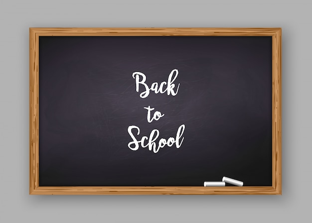Back to school text on chalkboard