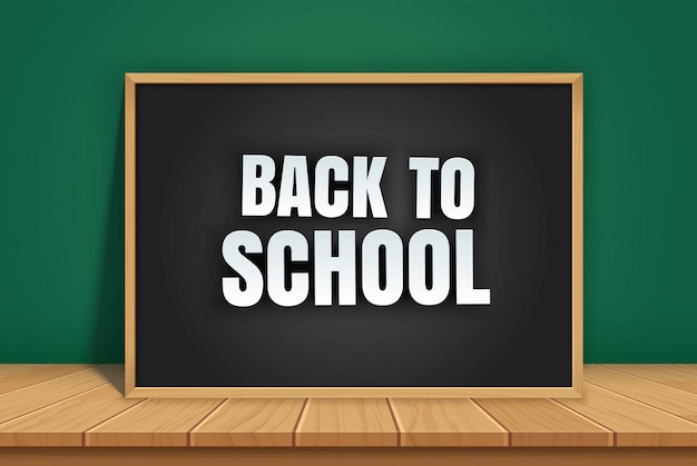 Back to school with black chalkboard on wooden table.