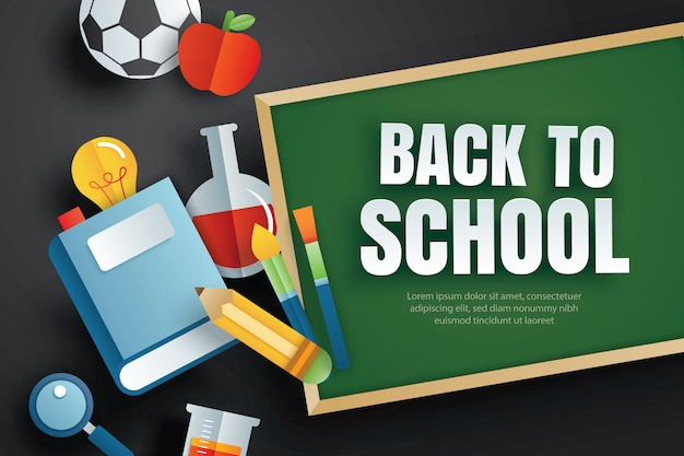Back to school with education items and green chalkboard.
