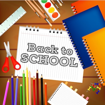 Back to school with school tools and wooden background