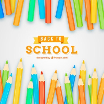 カラフルな鉛筆で学校の背景に戻る