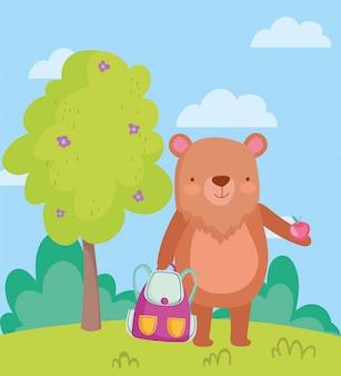 学校に戻って、バックパックとリンゴを持っているクマ