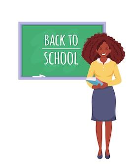 学校に戻る教室の黒人女性教師
