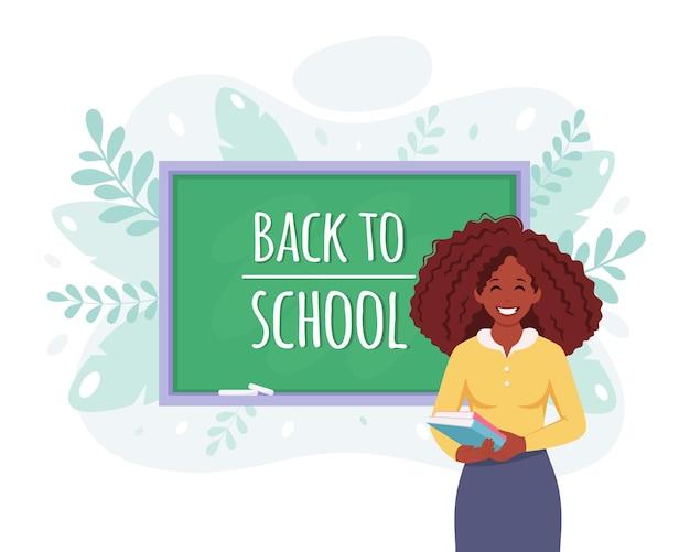 学校のコンセプトに戻る教室の黒人女性教師