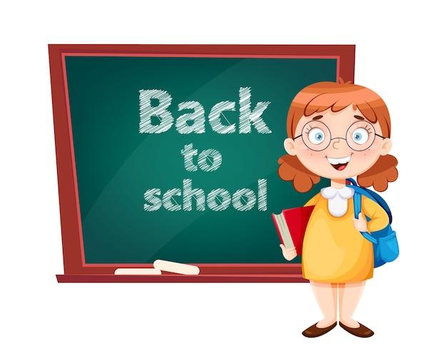 Обратно в школу милая школьница стоит возле классной доски забавный мультяшный персонаж