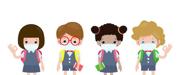 新しい通常の概念、顔の医療マスクを身に着けている子供たちのグループのために学校に戻って、covid19またはコロナウイルスを保護します